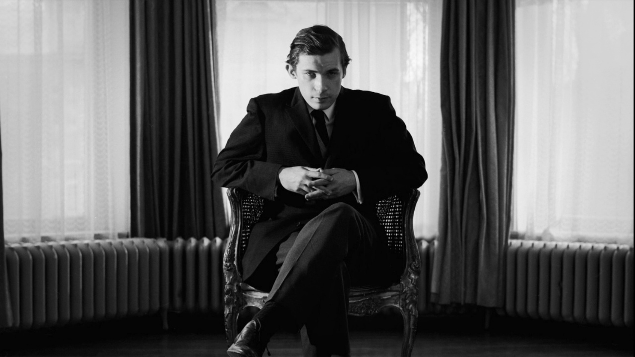 Glenn Gould sitting in chair